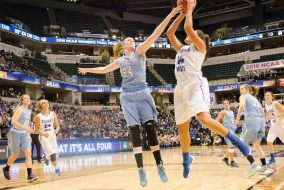 Senior forward/center Michela North contests a Thomas More player's shot in the NCAA Div. III women's basketball championship on April 4. (Evan Sayles / The Tufts Daily Archives)