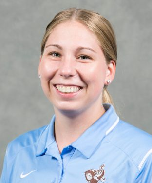 Women's basketball assistant coach Kate Barnosky, A12/AG14, poses for the team roster photo on Sept. 11, 2015. (Kelvin Ma/Tufts University)