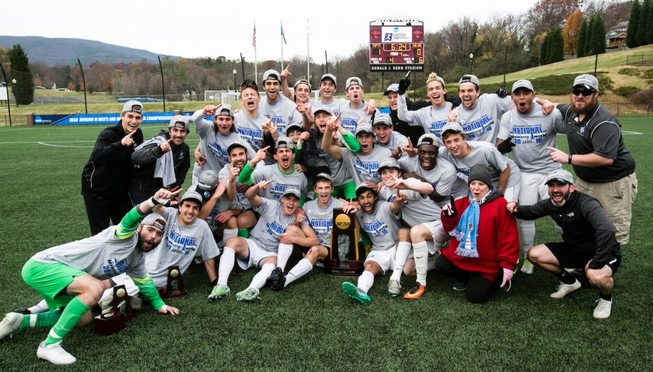 The Tufts University Men's Soccer Team cheers with the championship trophy after the match against Calvin College of the national NCAA Division III men's soccer tournament on December 3, 2016. The Jumbos defeated the Knights 1 to 0 in double overtime. (Alonso Nichols/Tufts University)