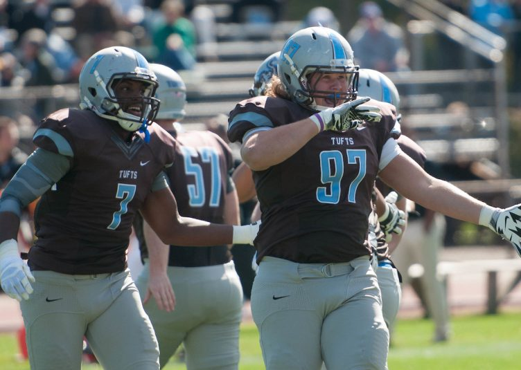 Junior defensive lineman Micah Adickes celebrates his interception just seconds after Bowdoin gained its first possession of the homecoming game on Oct. 10, 2015. (Evan Sayles / The Tufts Daily Archive)