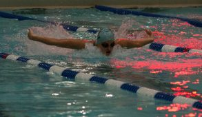 Then-first-year Colleen Doolan swims butterfly in a dual matchup against Wheaton College on Jan. 23. (Julia Press / The Tufts Daily Archives)