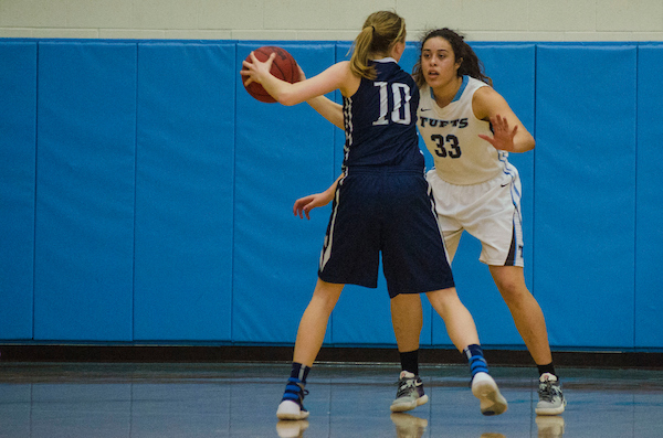 Sophomore Melissa Baptista blocks a Middlebury player during Tufts women's basketball's   68-36 victory at home in Cousen's gym on Feb. 20.    Ray Bernoff/The Tufts Daily Archives