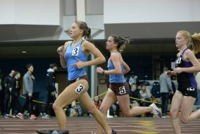 –Tufts senior Audrey Gould, front, and junior Brittany Bowman compete in the Women's 5000 Meter race during the Final Qualifying Meet in Gantcher Center on March 4, 2016. (Sofie Hecht / The Tufts Daily)