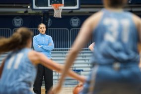 Tufts head coach Carla Berube observes the team during a drill at Hinkley Fieldhouse, Butler University on Sunday, April 3, 2016. (Evan Sayles / The Tufts Daily)