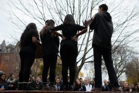 Members of Tufts United for Immigrant Justice speak to students and community members during a rally demanding that Tufts become a sanctuary campus, following a campus-wide walkout, on Nov. 16. (Evan Sayles / The Tufts Daily)