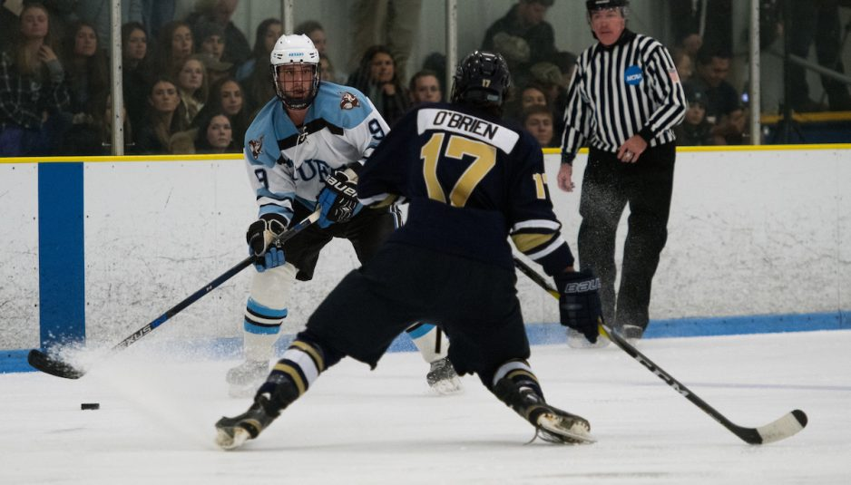 Junior forward Brian Brown looks for a pass past a Trinity defender in the home opener against the Bantams on Nov. 18. (Evan Sayles / The Tufts Daily)