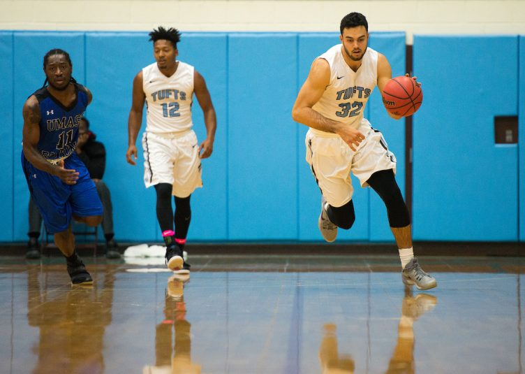 Senior center Drew Madsen dribbles down the court in the game against the UMass Boston Beacons on Dec. 6. (Evan Sayles / The Tufts Daily)
