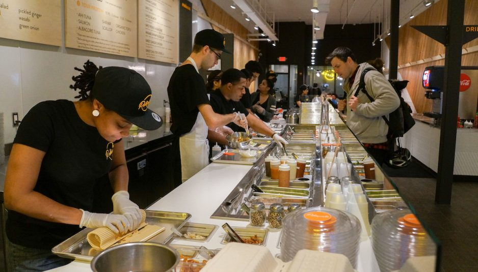 Workers at Pokeworks prepare an order on Dec. 6. (Seohyun Shim / The Tufts Daily)