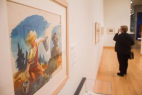 "A museum-goer checks out the MFA's new exhibition, ""Make Way for Ducklings: The Art of Robert McCloskey,"" on Dec. 7. (Max Lalanne / The Tufts Daily)"