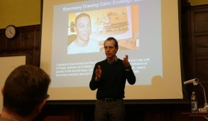 Paul Beran, director of the SHARIAsource project at Harvard Law School, speaks during his lecture on Arab political cartoons in the Crane Room on Nov. 30. (Seohyun Shim / The Tufts Daily)