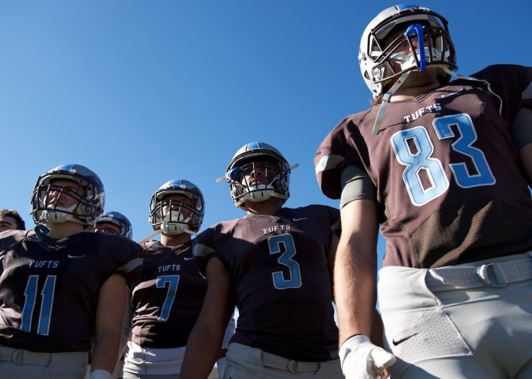 Members of the football team, including senior tri-captain running back and reigning NESCAC Offensive Player of the Year Chance Brady (middle), watch the game against Colby on Nov. 5. (Angelie Xiong / The Tufts Daily)