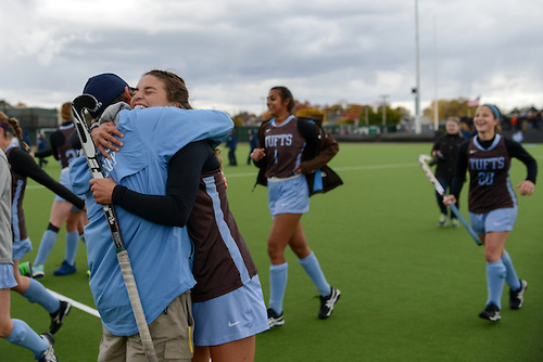Members of the field hockey team run back to hug the coaching staff after winning the NESCAC championship game against the Middlebury College Panthers on Nov. 6, 2016. (Evan Sayles / The Tufts Daily)