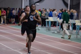 Then-junior sprinter Niticon Davis competes at the Tufts Stampede on Jan. 30, 2016. (Alex Knapp / The Tufts Daily)