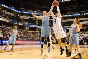 4/4/16 – Indianapolis, IN – Senior forward/center Michela North reaches to block a shot by a Thomas More player in the NCAA Div. III women's basketball championship on April 4, 2016. (Evan Sayles / The Tufts Daily)