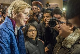 Sen. Warren spoke at a protest against Trump's anti-immigration executive order at Logan Airport's international arrivals terminal on Jan 28, 2016. (Ray Bernoff / The Tufts Daily)