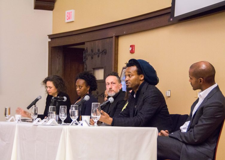 "1/23/2017 - Medford/Somerville, MA - Brandeis University professor Dr. Greg Childs speaks in a panel with other historians during the ""Where Do We Go From Here? Chaos or Community"" Martin Luther King, Jr. Symposium organized by Tufts University in Breed Memorial Hall on Jan. 23. (Max Lalanne / The Tufts Daily)"