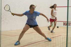 Junior Lauren Banner swings at the ball in a match against Dickinson at Harvard's Murr Center on Jan 20. (Ray Bernoff / The Tufts Daily)