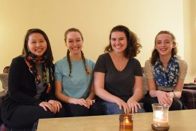 Tai Williams, Sydney Giacalone, Selena Groh and Harper Hopkins, the organizers of Avian pose for a group photo.  (Margot Day / The Tufts Daily)
