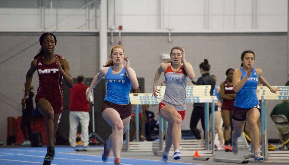Freshman Alina Strileckis (left) runs in a sprint with teammate and sophomore Patricia Blumeris at the Cupid Challenge held at Tufts University on Feb. 4. (Max Lalanne / The Tufts Daily)