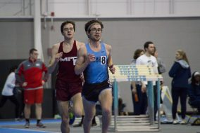 Senior Tim Nichols holds the lead in a 5,000-meter race at the Cupid Challenge held at Tufts on Feb. 4. (Max Lalanne / The Tufts Daily)