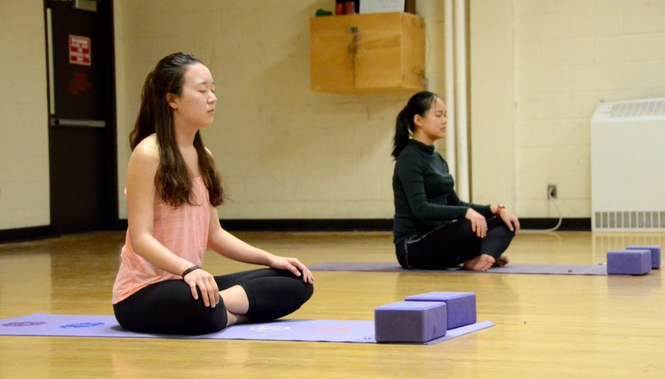 07/02/2017 - Medford, MA - Students practice mental mindfulness by taking a break from studying to do yoga in Hill Hall on Feb. 7th. (Rachael Meyer / The Tufts Daily)