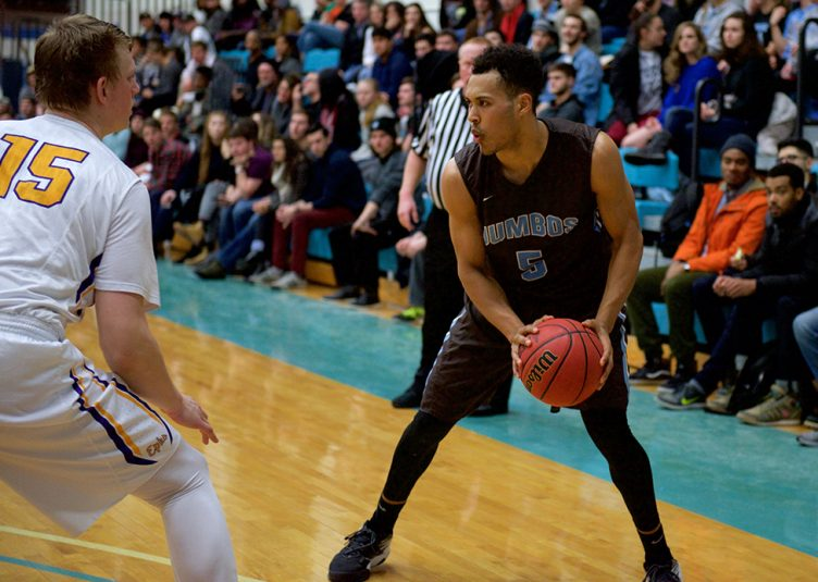 Junior KJ Garrett looks to pass during the men's basketball game against Williams College on Feb. 10. (Angelie Xiong / The Tufts Daily)