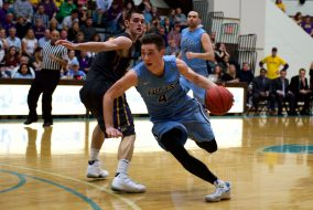 Junior Everett Dayton cuts past a William' defender on Feb. 25. (Angelie Xiong / The Tufts Daily)