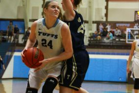 Senior Michela North runs past an opponent in a game against Trinity College on Feb 3. (Sitong Zhang / The Tufts Daily)