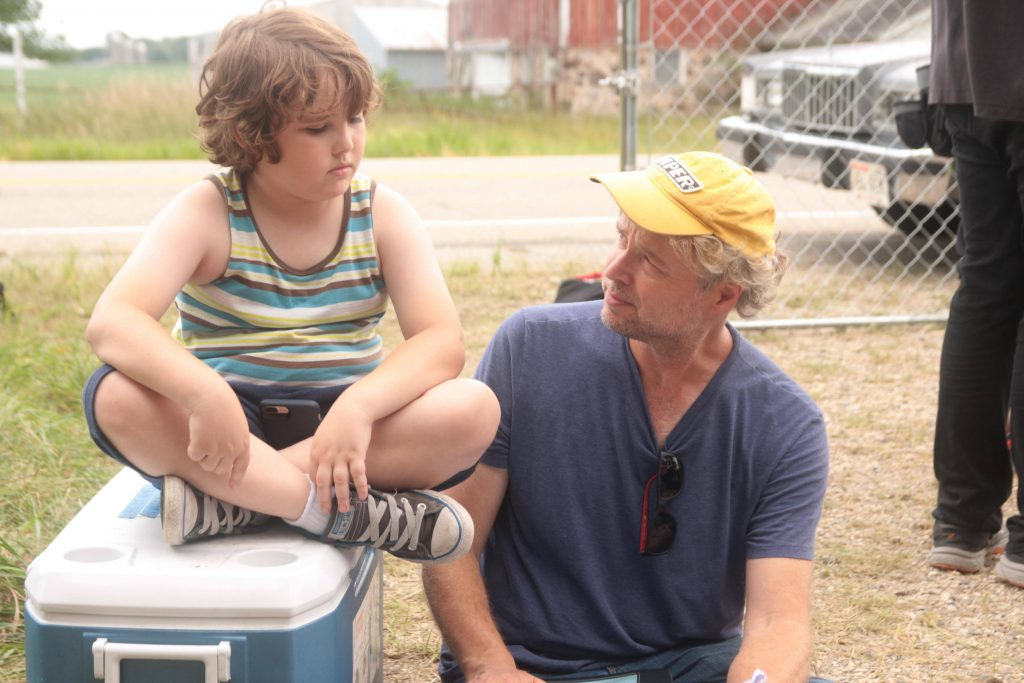 "Cooper J. Friedman (left) and Niels Mueller (right) are pictured while filming ""Small Town Wisconsin"" (2020)."